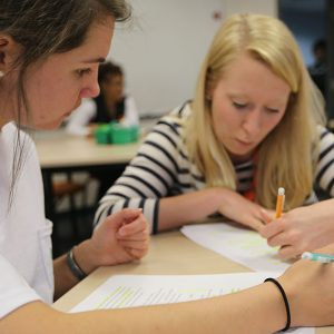 WPU students working together in the classroom.