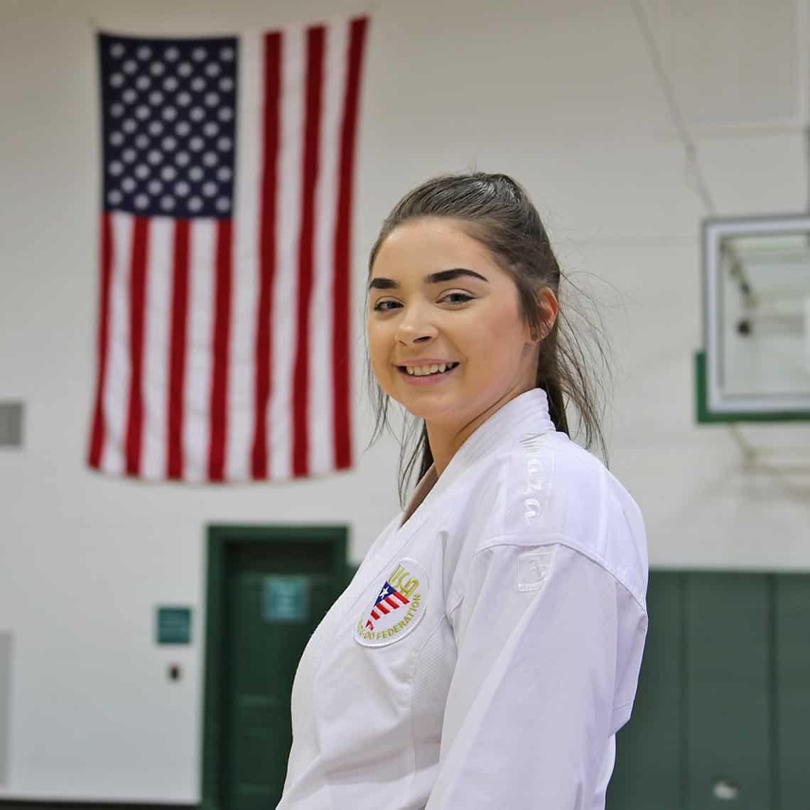 WPU Student, Aerieal Vineyard, throws a Karate kick.