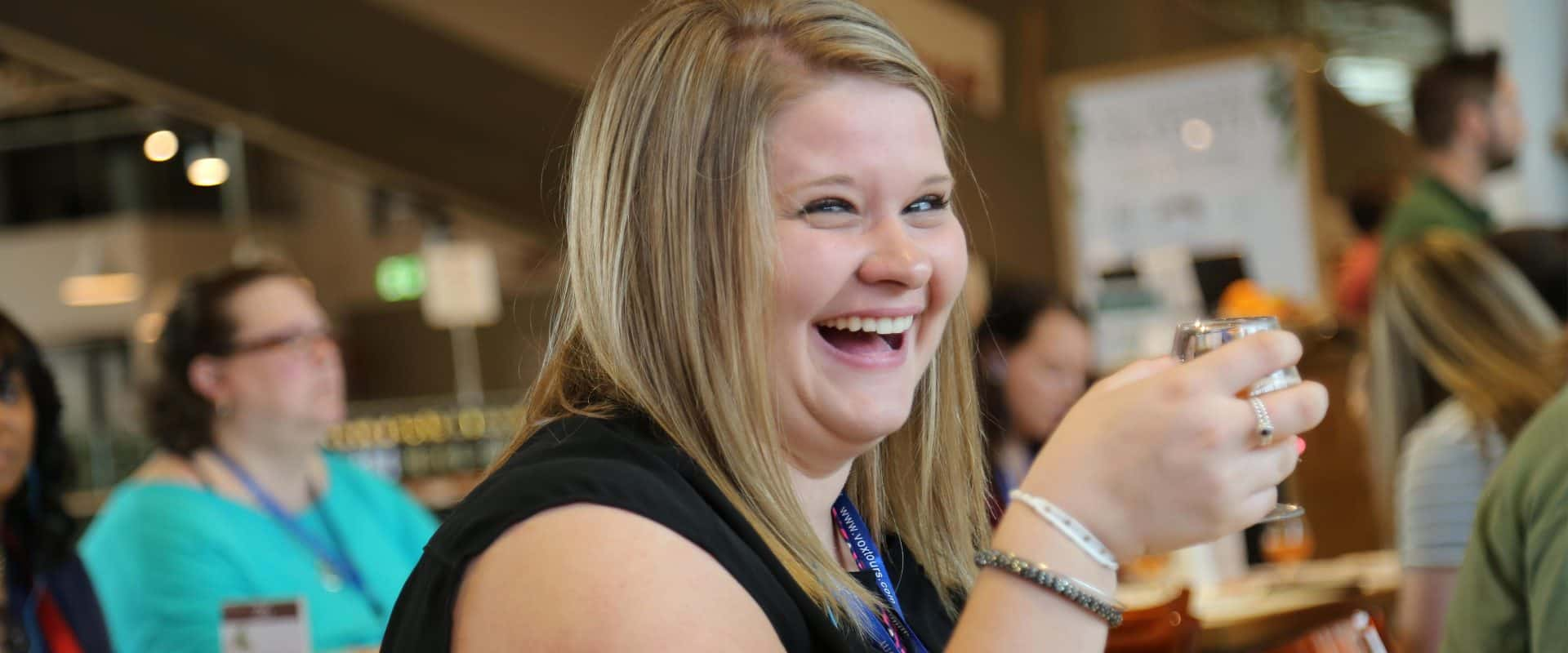 An alumna smiles at a WPU networking event.