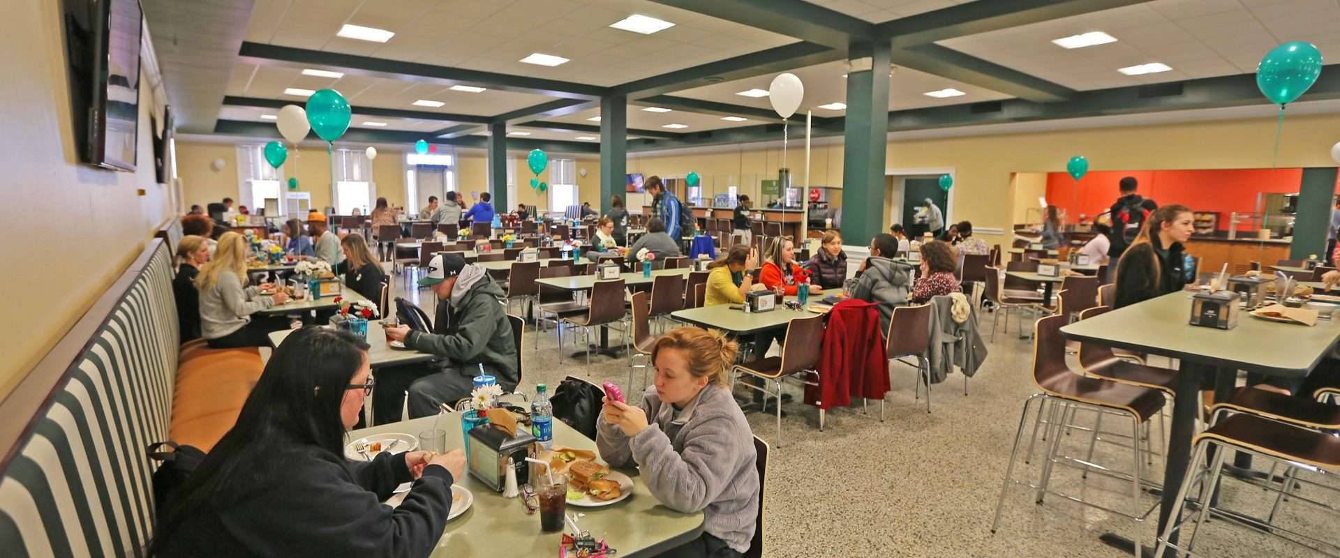 students eating in belk dining hall.