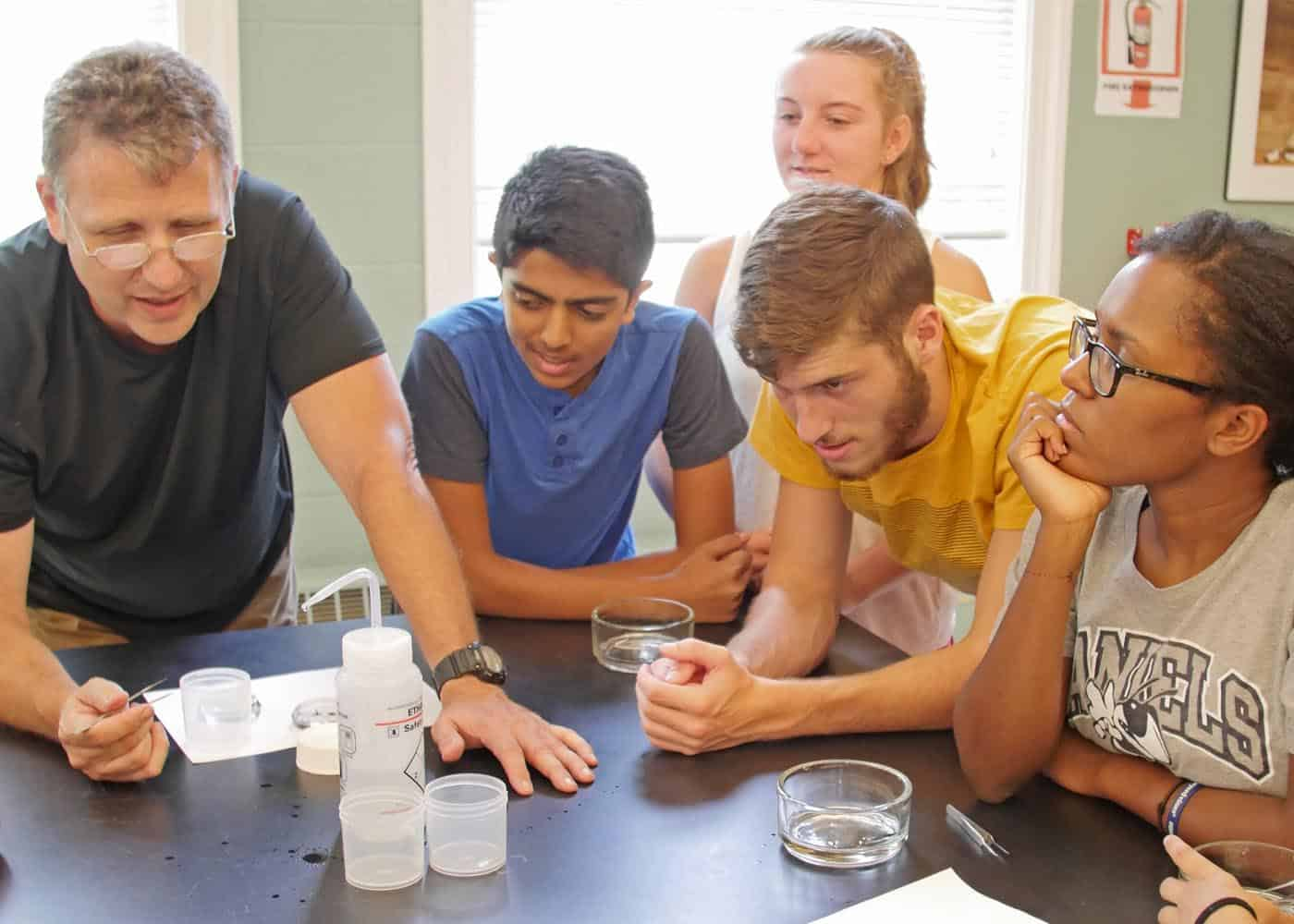 WPU students and faculty conduct experiments in the lab.