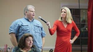 Kathryn Brown interviews audience member to help find Santa Claus.