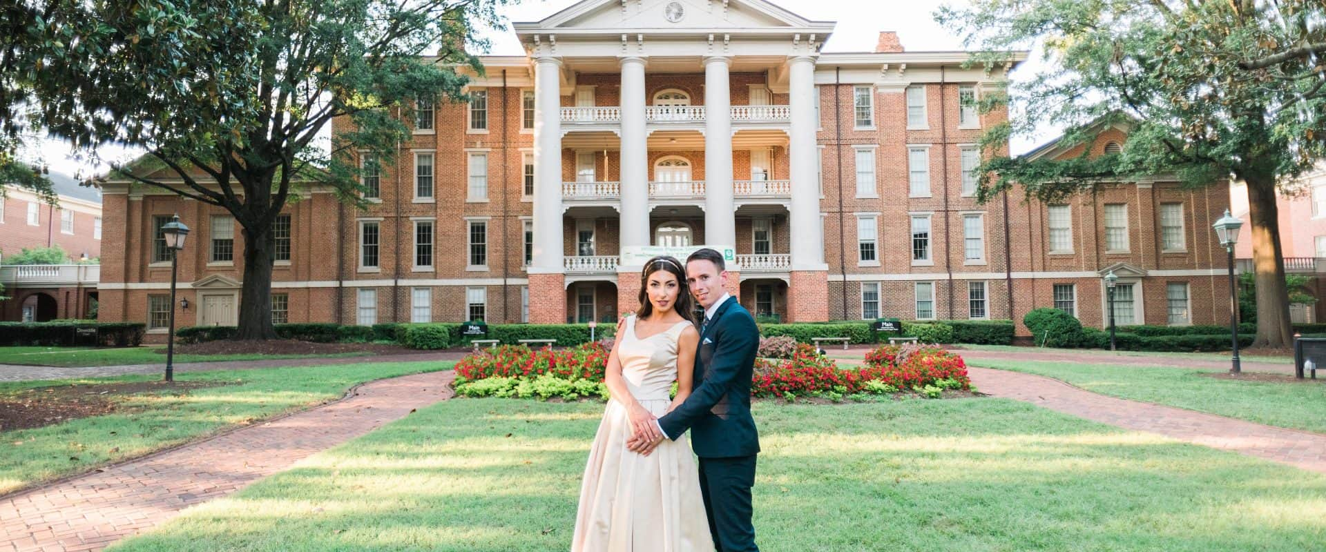 A bride and Groom in front of Main Building after being married on campus.