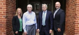 "VP of Advancement, Jodi Stamey (left) meeting with David T. ""Tim"" Clancy (middle left) and Joel T. ""Tick"" Clancy (middle right) and WPU President, Dr. Brian Ralph (right)."