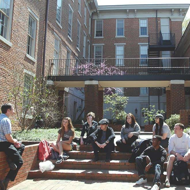 WPU Students and faculty in discussion outside on campus.