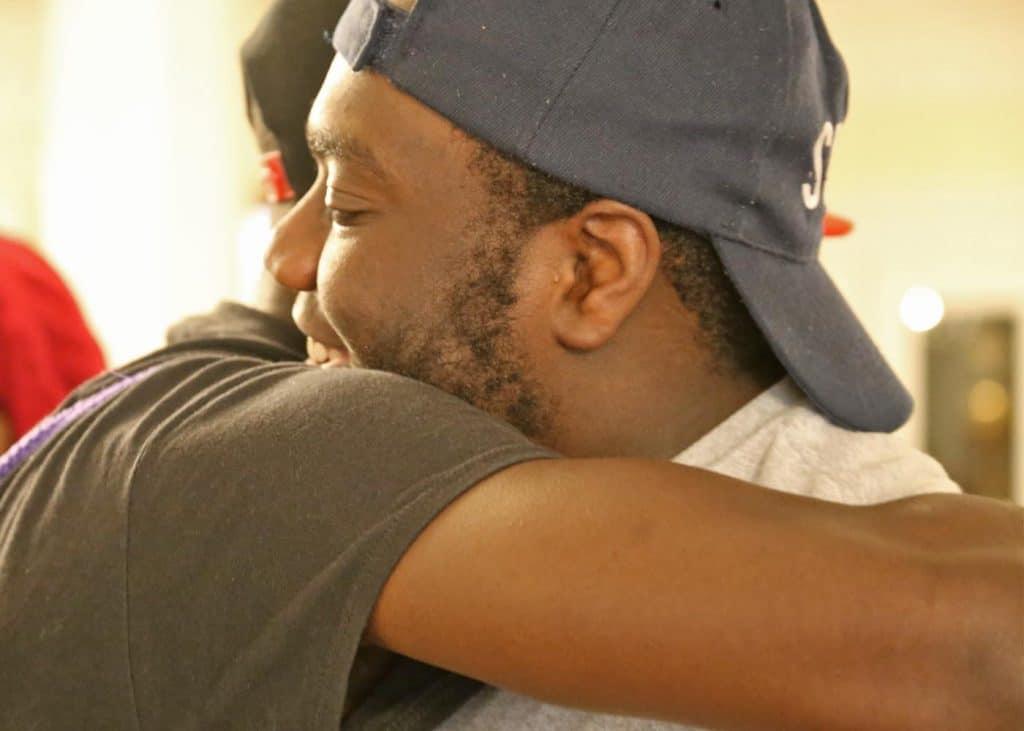 WPu students embrace for a hug