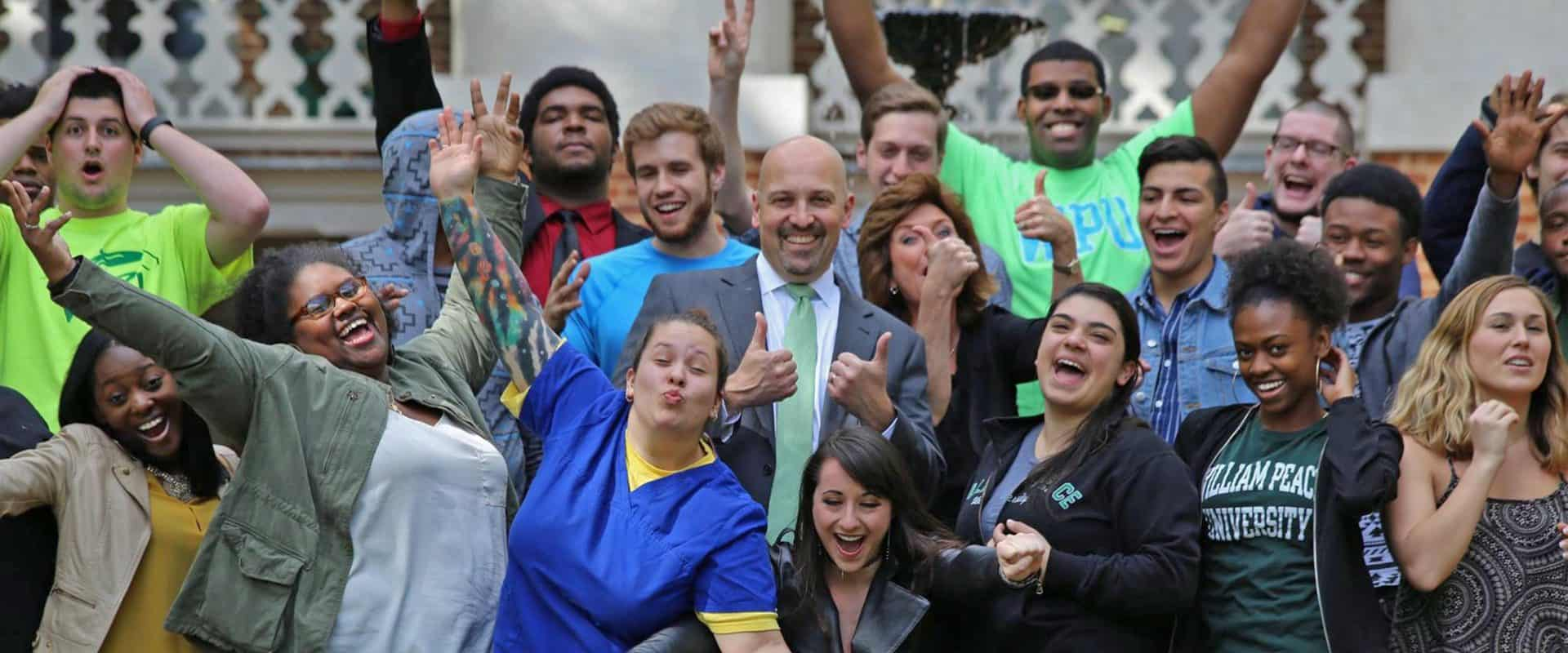 Dr. Brian Ralph, President of William Peace University and WPU Students.