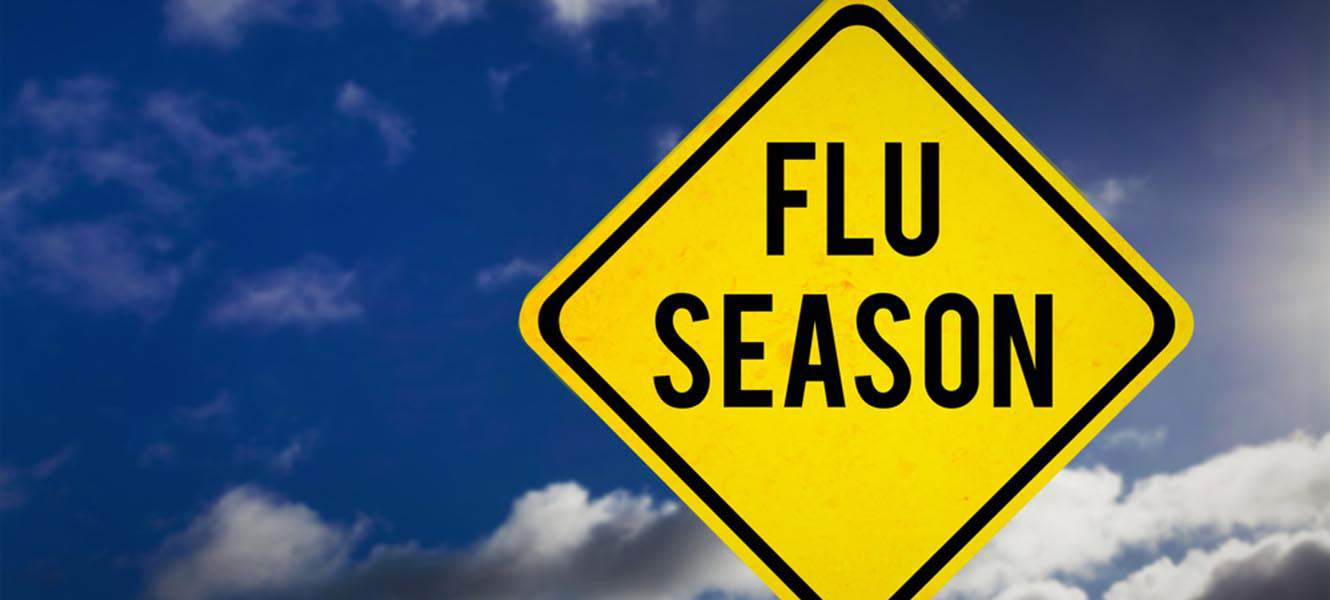 A sign warning about flu season