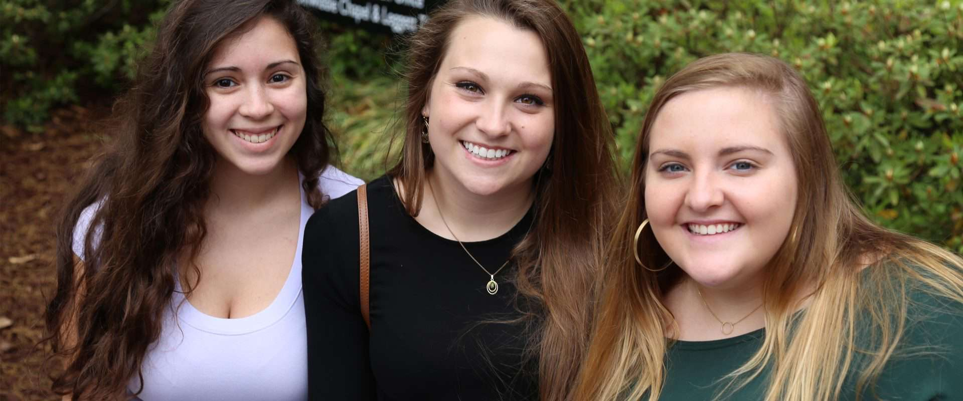 WPU students smiling on campus.