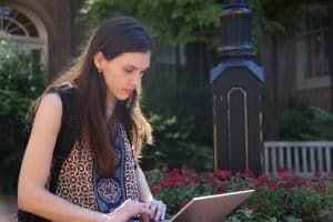 WPU student, Grace Robinson, looks over her schoolwork on campus.