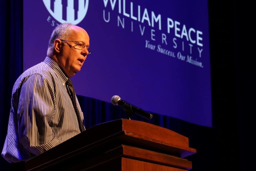 WPU Professor Roger Christman speaks at Showcase.