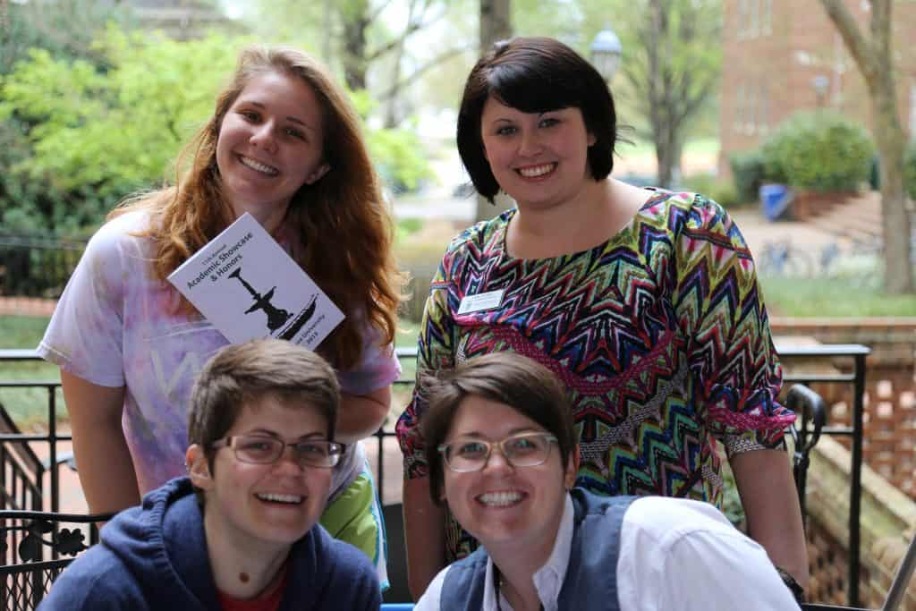 WPU students and staff smile on campus.