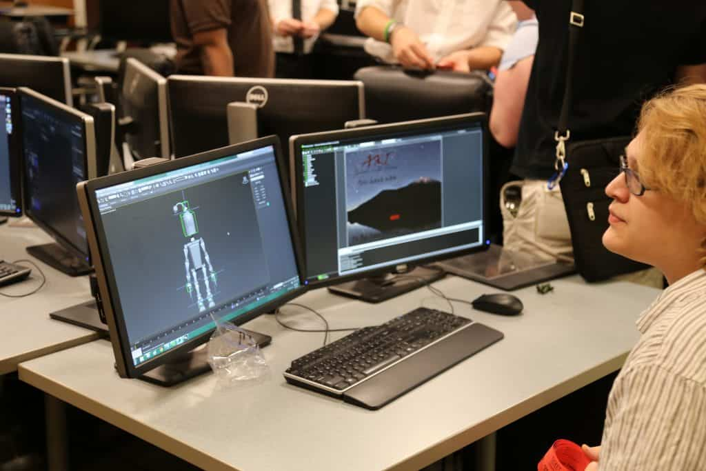 WPU student tests simulation and game design equipment.