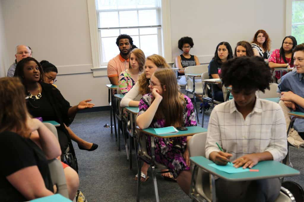WPU students have a discussion in class.