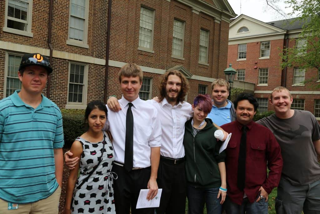 WPU students smile on campus.