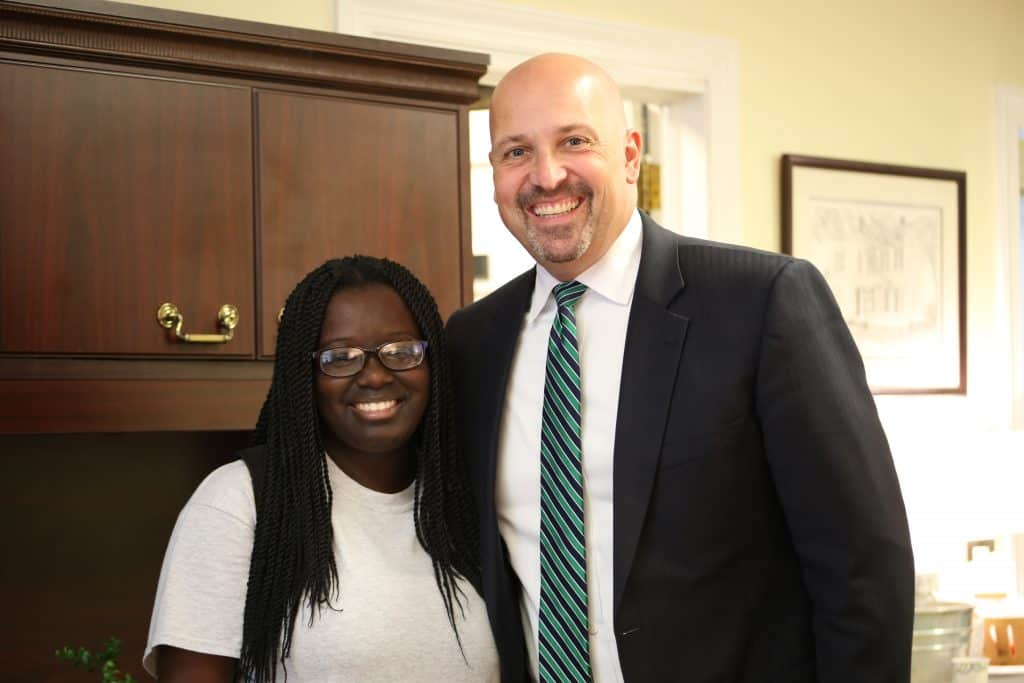 Dr. Ralph poses with a student who popped into his office