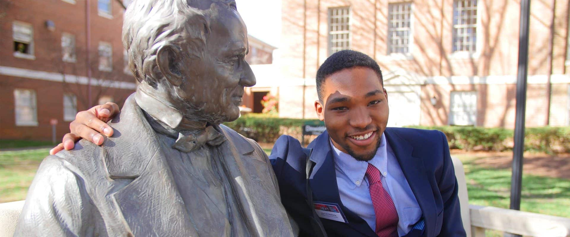 WPU Student, Jay Len with Mr. Peace statue.