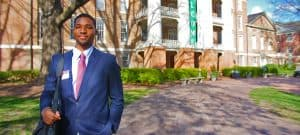 WPU Student, Jay Len poses in front of Main Building.