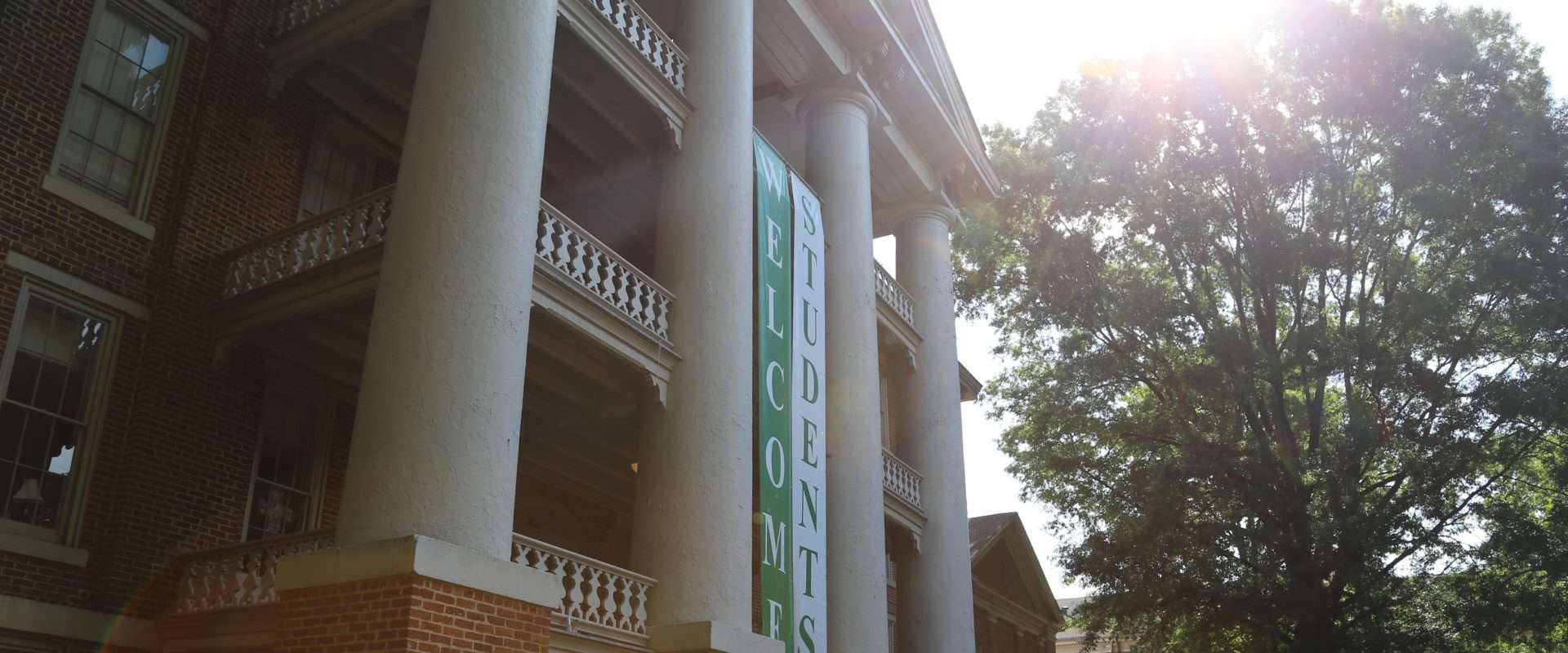 Main Building with Welcome Students Banners