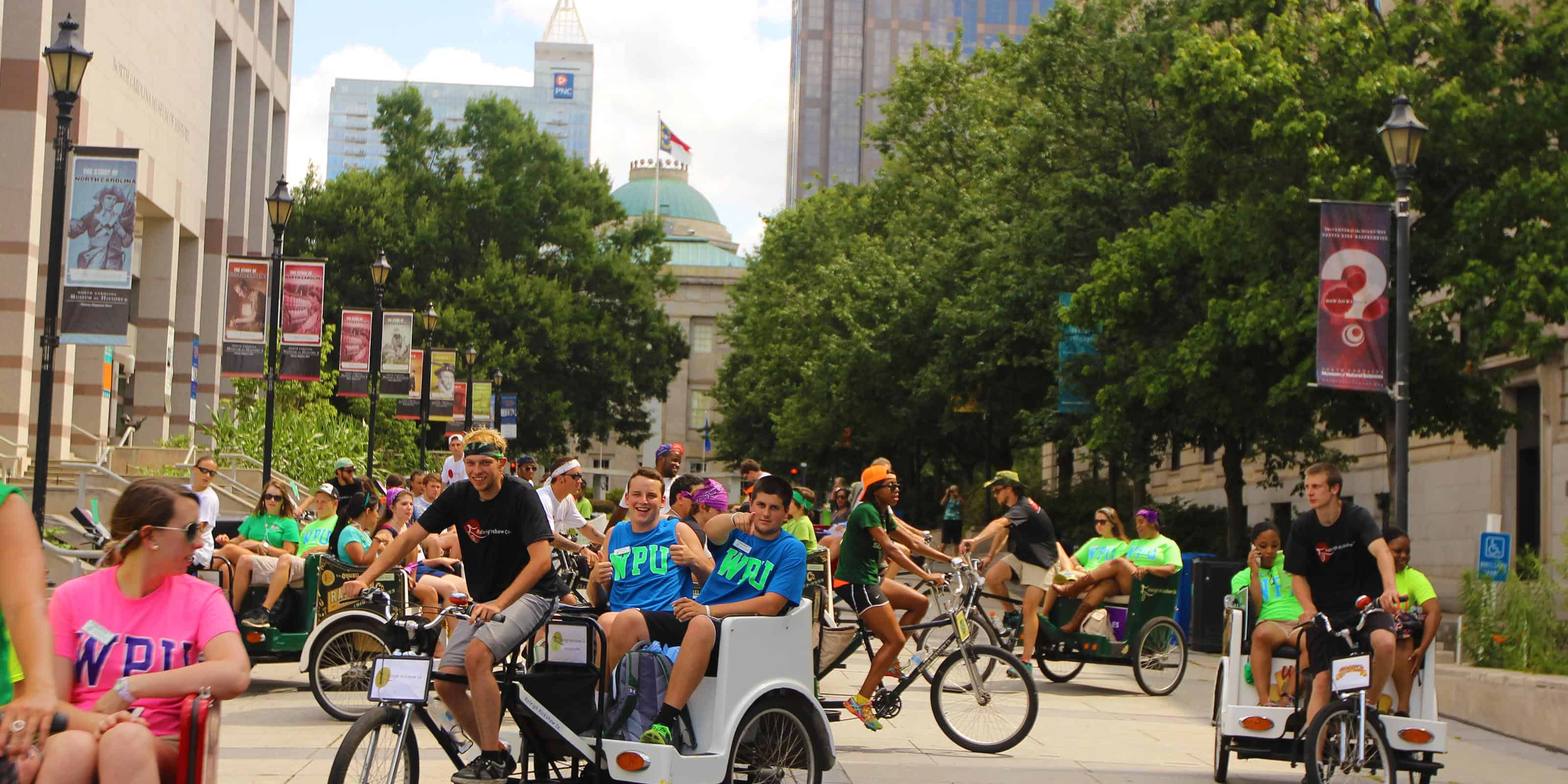 WPU students riding a rickshaw in Downtown Raleigh.