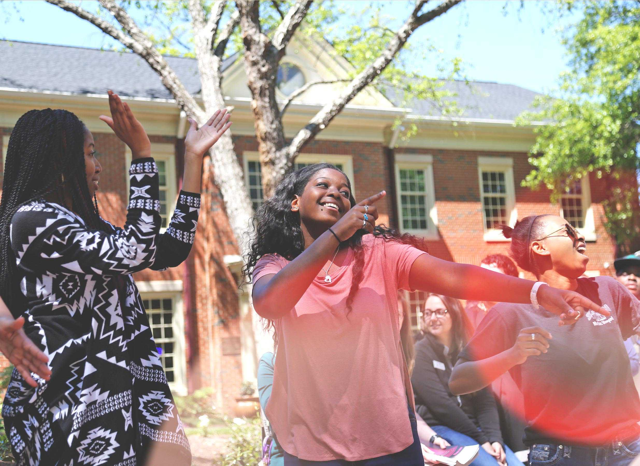 WPU Students singing and dancing on campus.