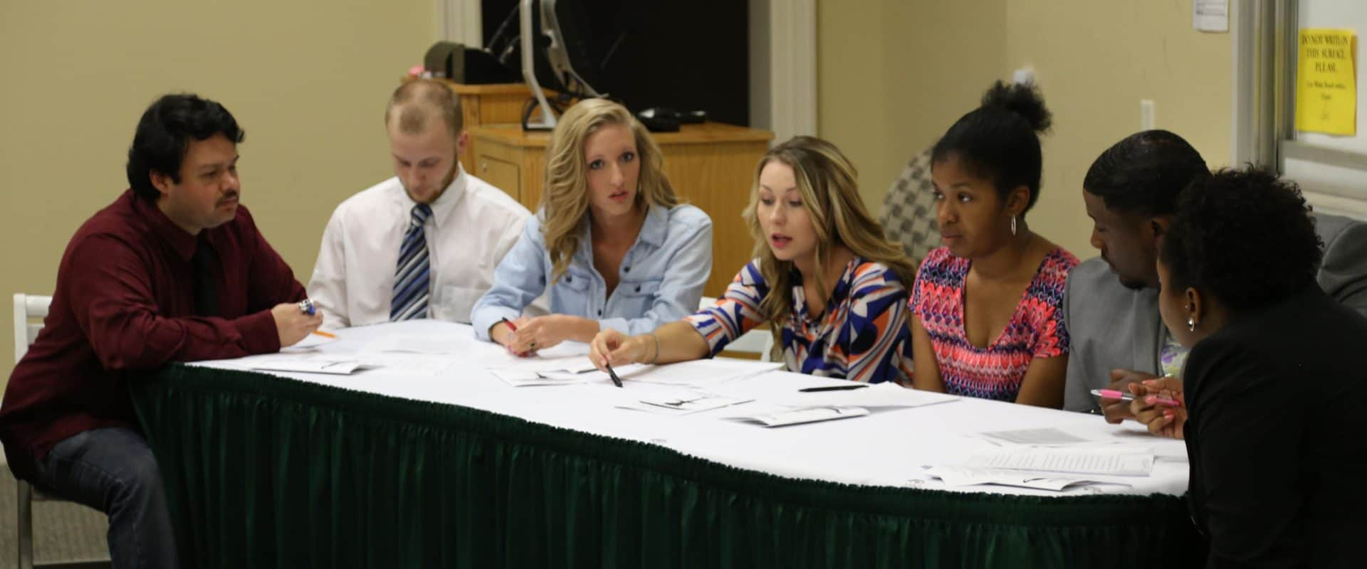 Students in a debate at WPU Academic Showcase.