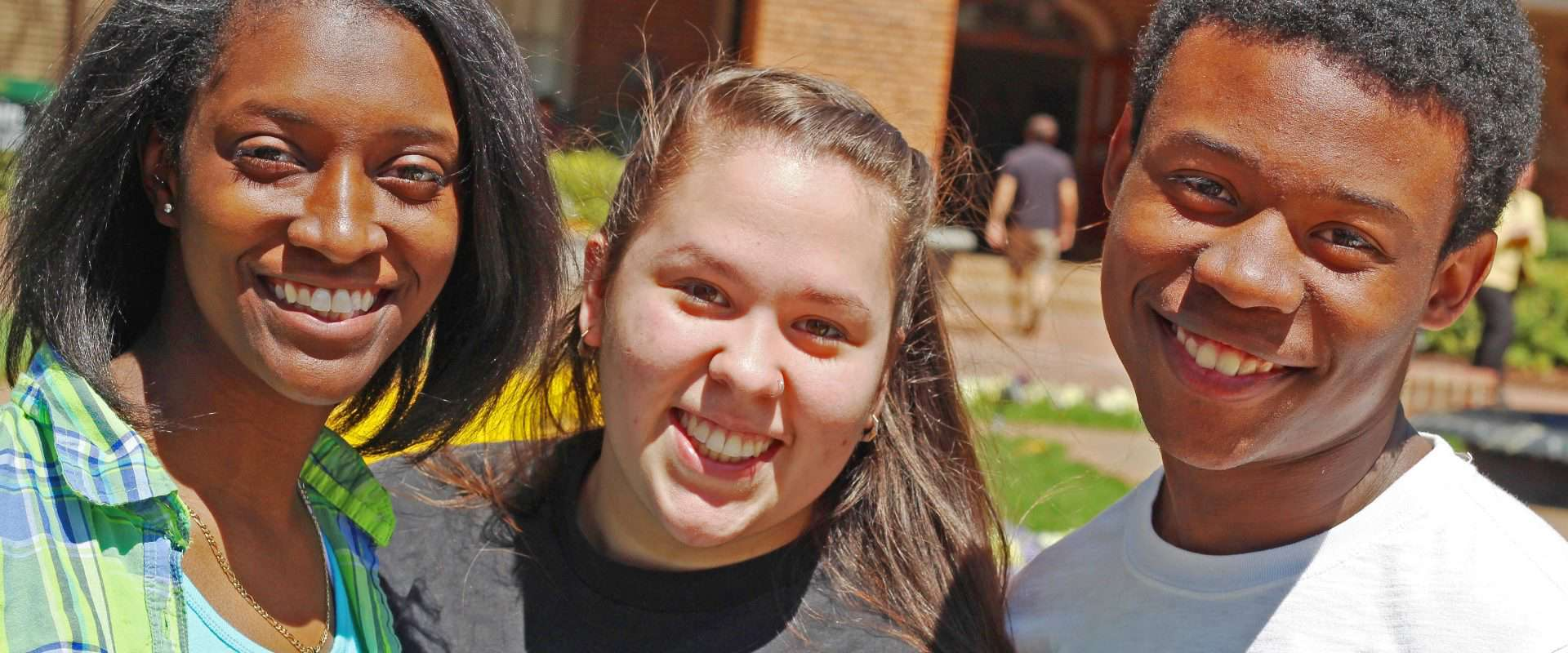 WPU students smile at school event.