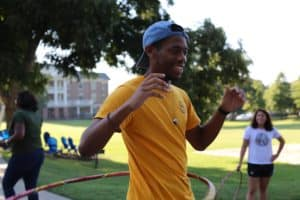 WPU student smiling at a student life event.