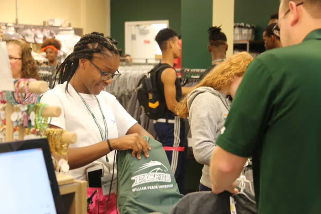 WPU student makes a purchase at the campus bookstore.