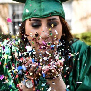 WPU graduate celebrates with glitter.