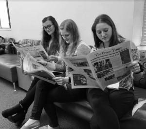 WPU students read copies of The Peace Times newspaper.