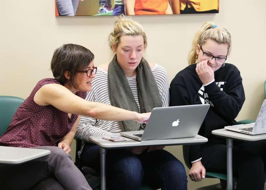 WPU students receiving tutoring help.